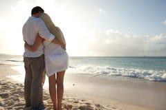 Vacation Couple on Beach Stock Photo