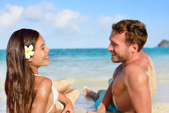 Vacation couple relaxing on beach tanning Royalty Free Stock Photography
