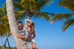 Vacation couple relaxing on beach together in love. Royalty Free Stock Images