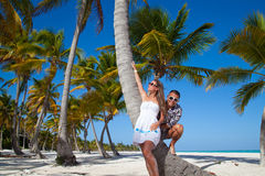 Vacation couple relaxing on beach together in love Stock Photography