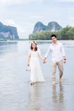 Vacation couple walking on beach. Stock Image