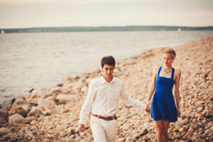 Vacation couple walking on beach together Royalty Free Stock Photos