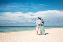 Vacation Couple walking on tropical beach Maldives Stock Photography