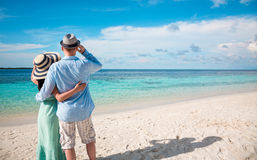 Vacation Couple walking on tropical beach Maldives Stock Photo