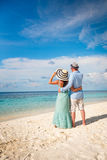 Vacation Couple walking on tropical beach Maldives. Royalty Free Stock Photo