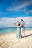 Vacation Couple walking on tropical beach Maldives. Royalty Free Stock Photo