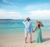 Vacation Couple walking on tropical beach Maldives. Stock Image