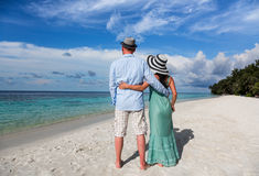 Vacation Couple walking on tropical beach Maldives. Stock Photos