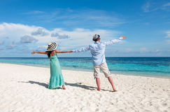 Vacation Couple walking on tropical beach Maldives. Stock Photo