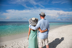 Vacation Couple walking on tropical beach Maldives. Royalty Free Stock Photos