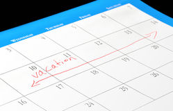 Vacation dates on a calendar. Calendar page with days marked for a vacation royalty free stock images