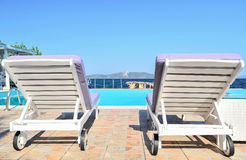 Deck chair. Near pool with sea view Stock Image