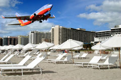 Vacation destination. Airplane arriving at resort destination Royalty Free Stock Photos