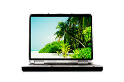 Vacation dreams. At home, laptop with image of the beach Stock Photos