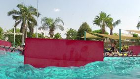 Vacation enjoyment. A girl having fun in resort village stock video footage