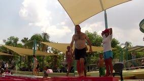 Vacation enjoyment. Having fun in resort village stock video footage