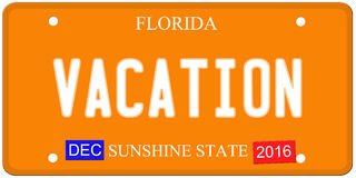 Vacation Florida License Plate. An imitation Florida license plate with December 2016 stickers and VACATION written on it making a great concept.  Words on the Royalty Free Stock Photo