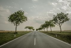 Vacation Getaway Road. Scenic Vacation Getaway Road. Countryside Highway with Trees Along Royalty Free Stock Photography