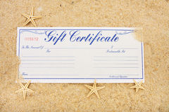 Vacation Gift Certificate. A gift certificate sitting on a beach with starfish, vacation gift certificate stock photography