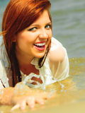 Vacation. Girl in water having fun on the sea. Royalty Free Stock Photos