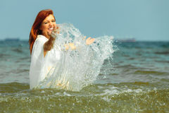 Vacation. Girl in water having fun on the sea. Stock Image