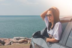 Vacation and Holiday Concept : Happy family car trip at the sea, Portrait woman wearing sunglasses and feeling happiness. Vacation and Holiday Concept : Happy stock photography