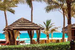 Vacation holidays background. Pavilion and sunbeds on ocean coas. T Royalty Free Stock Images