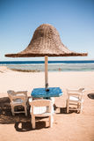 Vacation holidays. three beach lounge chairs under tent on beach. Stock Images
