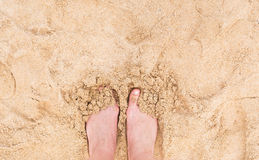 Vacation holidays. Woman feet closeup of girl relaxing on beach in sunny summer day. Royalty Free Stock Photos