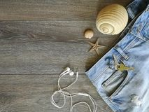 Vacation holyday and travel trip. To the favorite destination. Jeans and seashell background texture  object details abstract textil industrial sea space Royalty Free Stock Image