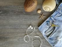 Vacation holyday and travel trip. To the favorite destination. Jeans and seashell background texture object details abstract textil industrial sea space royalty free stock photo