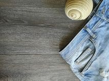 Vacation holyday and travel trip. Vacation holyday an travel trip to the favourite destination. Jeans and seashell background texture object details abstract stock photography