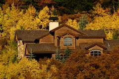 Vacation Home. House surrounded by autumn trees Royalty Free Stock Photography