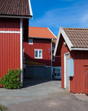 Vacation homes in Sweden. Some vacation homes on a swedish island. The buildings are painted in typical swedish red and white Royalty Free Stock Image