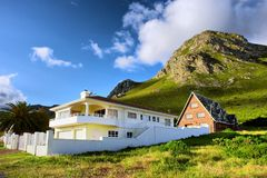 Vacation house among awesome mountains Royalty Free Stock Photos