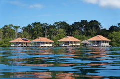 Vacation houses over the sea with water surface Royalty Free Stock Images