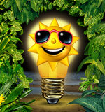 Vacation Ideas. And holiday planning solutions with a happy sun character in a shinning glowing light bulb in a night time tropical plants setting as a travel Stock Photo