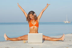 Vacation laptop. Woman on summer beach vacation with laptop Stock Images