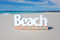 Vacation Life is better at the beach scene Stock Images