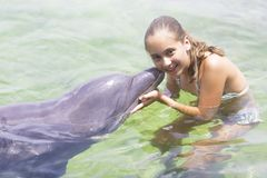 Vacation Lifestyle -Happy teenager hugging a dolphin Royalty Free Stock Photo