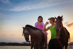 Vacation Lifestyles. Couple Horseback Riding at Stock Image