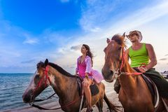 Vacation Lifestyles-Couple Horseback Riding at Stock Image