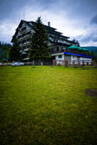 Vacation lodge and meadow Royalty Free Stock Photo