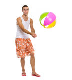 On vacation man playing volleyball with beach ball Stock Photo