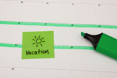 Vacation marked in calender. With green pen Royalty Free Stock Image