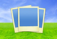 Vacation Memories. (polaroid photo frames against sky&grass background). Contains clipping paths for easy framing your pictures if needed royalty free stock photo