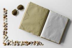 Open empty photo album, sunglasses and seashells. royalty free stock photo