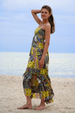 Vacation near sea. Pretty woman with variegated dress in Sventoji beach, near Baltic sea, Lithuania Stock Photo