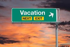 Vacation Next Exit Freeway Sign with Sunset Sky Royalty Free Stock Photos