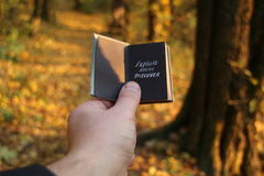 Vacation packages idea. Explore Dream Discover text. Hand holding a book with the inscription Explore Dream Discover Royalty Free Stock Photos
